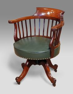 """Good quality nineteenth century mahogany captains chair. Shaped head rail and arm rests on slender supports over a leather stuffover seat. Raised on a base of four hipped splay legs with scrolling toes capped with castors.  circa. 1880 Height32"""" (81cm) Width21"""" (53cm) Depth22"""" (56cm) £1400.00 - See more at: http://www.thakehamfurniture.co.uk/recent-acquisitions/recent-purchases-now-in/antique-captains-chair-20-58-refno-2475/#sthash.oCTyKX2l.dpuf"""