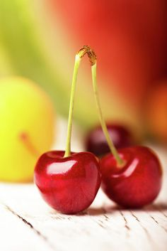 Vadim Goodwill Print featuring the photograph Two Cherrie by Vadim Goodwill Two cherries an other fruits on a wooden table by Vadim Goodwill #VadimGoodwill #FineArt #ArtforHome #DesignDecor #Paint#cherry