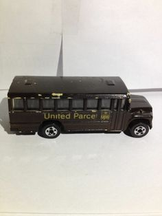 """HOT WHEELS FORD CHASSIS UPS UNITED PARCEL SERVICE BROWN SCHOOL BUS. Does UPS have any school buses? I really doubt it, someone customized this bus into one! Bus is in good condition with some paint chips on the roof, edges and the hood. 3"""" long X  1"""" high X 1"""" wide, die cast metal, chrome wheels with black plastic tires, Brown Paint job with Gold Trim, has the UPS Shield on both sides and on the rear emergency door with """"UNITED PARCEL"""" on the door side."""
