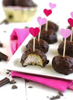 Raspberry Cheesecake Stuffed Coconut Quinoa Bites with Dark Chocolate Glaze - Creamy, chocolatey and secretly healthy and gluten free! They're perfect for Valentines Day! | Foodfaithfitness.com | #recipe