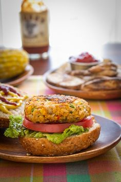 Spicy BBQ Chickpea Burgers, OhSheGlows (garbanzo beans, brown rice, sunflower seeds and pepitas, garlic, red pepper, jalapeno, red onion, carrot, parsley, BBQ sauce, breadcrumbs, flax meal, red pepper flakes)  [Vegan]