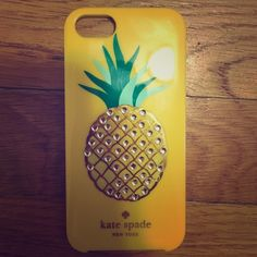 Kate Spade Rhinestone Pineapple iPhone 5/5s case Kate Spade Rhinestone Pineapple case for iPhone 5/5s. Is currently missing 8 rhinestones and has small amounts of scratches but is otherwise in very good condition. I bought while I was in Las Vegas in August and within an hour of using it one of the rhinestones had already fallen off. You could very easily find replacement rhinestones and superglue or E6000 them back on and I'm sure they would stay. Willing to accept reasonable offers. NO…