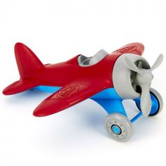 Green Toys Airplane - Made in the USA from recycled plastic milk jugs that save energy and reduce greenhouse gas emissions, this single-seater plane features a spinning propeller, two-wheeled landing gear, and racing stripes on its rounded wings. Plastic Milk, Airplane Toys, Airplanes, Pilot Gifts, Green Toys, Toy R, Blue Wings, Racing Stripes, Fisher Price