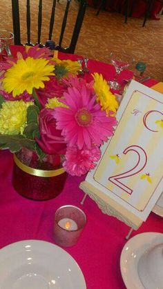 Hot pink and yellow table design with custom table numbers by Serendipity