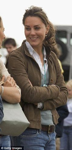 8/6/15 - Later, Kate ditches the hat and ties her hair up. I much prefer this look.