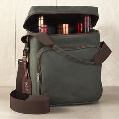 BYO in Style! Our new and improved waxed canvas 6-bottle wine bag, with insulation and an ice-pack for cooling, is perfect for that weekend getaway. Available with a monogrammed leather hang tag.