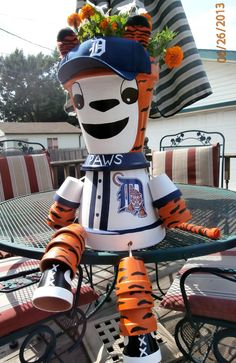 """This is the Detroit Tigers """"Paws"""" flower pot that I made for my daughter with flowers I planted in it."""