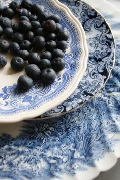 Blueberries on blue vintage china.