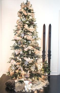 Ribbon garland on Christmas tree A ribbon is the perfect solution to concealing those bare spots in your Christmas tree while also adding a touch of color and texture. Christmas Tree Ribbon Garland, Decoration Christmas, Diy Christmas Tree, Rustic Christmas, Xmas Tree, Winter Christmas, Christmas Ideas, Ribbon On Tree, Christmas Lights