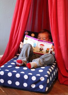Crib mattress upcycled into a reading nook