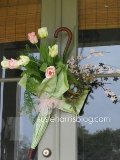 Tutorial for how to make those adorable umbrella door decorations the doors, door hangings, front doors, umbrella door, spring wreaths, may flowers, april showers, bridal showers, baby showers