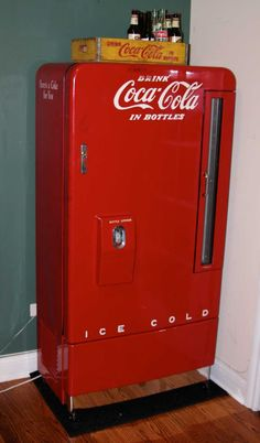 A Coca-Cola vending machine made in the late 40's early 50's. The Vendo 6-Case Vertical, vends 110 bottles, it has no coin mechanism, pre-cools 34 and weights 198 pounds. The cooler was designed primarily for indoor use. Typically, this machine would have been in the corner grocery store, a deli, or even the lobby of a gas station.