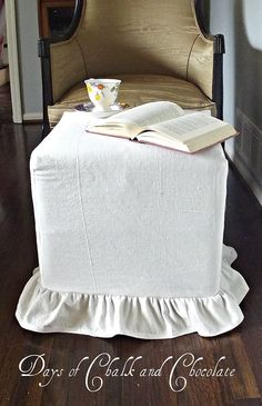 I used a simple drop cloth to create a ruffled slip cover for a cube ottoman. Easy and adds a bit of softness!
