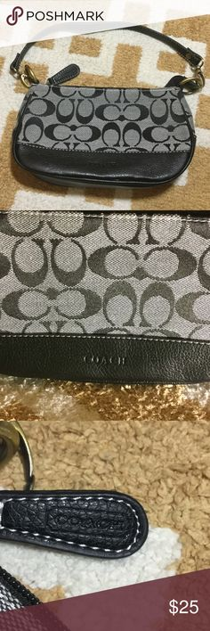Signature Coach small purse Gray & black signature Coach small purse.  Excellent used condition.  8 inches long.  5 inches high. Coach Bags Mini Bags