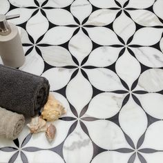 Home Discover Evangeline Nero Marquina And Calacatta Marble Tile For the bathroom floor Marble Tiles Calacatta Marble Tiling Tile Grout Marble Floor Mosaic Tiles Bathroom Inspiration Design Inspiration Terrazo