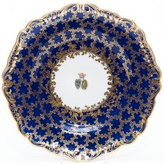 A Russian porcelain armorial plate by Imperial Porcelain Factory, period of Nicholas I, decorated with marriage coat-of-arms in the center. Manufacturer's mark in the back. SIZE: Diameter 9 5/8 in.