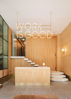 """Combining the flexibility of shared workspaces with the amenities of members clubs under the motto """"work is good"""", WOOD was conceived as a premium co-working space for Lisbon's freelancers, start-ups and other nomadic professionals. Commercial Interior Design, Interior Design Studio, Commercial Interiors, Lobby Reception, Reception Counter, Architecture Restaurant, Architecture Design, Office Signage, Best Architects"""