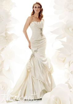 Gown features Swarovski crystals and handmade flower petals.