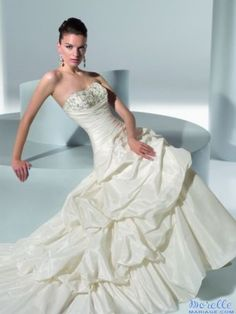 This dramatic Demetrios GR176 wedding dress is beautiful strapless, A-line gown with ruching made from luxurious taffeta, and stunning bead work on the bodice. This gown has a bustled skirt, and train with a lace-up bodice in the back. This gown retails for $1000. Selling for only $180. Email me at somethingnewbyt@gmail.com