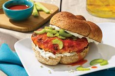 The classic Buffalo wings condiments—blue cheese, celery and hot sauce—are all here, ready to transform chicken burgers into family party fare.