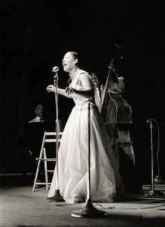 Billie Holiday, with Teddy Wilson at the piano and Milt Hinton on bass. Newport Jazz Festival in July 1954, five years from the close of her career and the end of her life.  John Vachon for Look magazine.