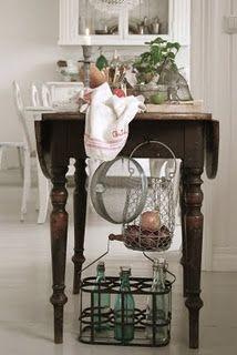 What a fun idea! Using a drop leaf table as a kitchen island!