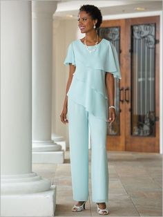 Flowing, flattering tiers are just the beginning for this gorgeous ensemble. Designed in lighter-than-air georgette that perfects the classic-meets-romantic allure you love. The lined top is designed with a scoop neckline and short sleeves. The hem dips to a dramatic point on one side. Pull-on pants include an all-around elastic waistband.