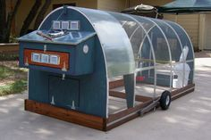 Now this is a fancy chicken tractor! I wonder if I have the skills to diy this...