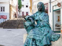 Statue in Coimbra, Portugal  Central Portugal - Coimbra and Viseu are small cities full of history and beauty Photos by Paul Shoul, text by Max Hartshorne of GoNOMAD Travel Centro de Portugal Region