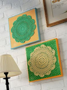 doily wall art with mod podge. except i would use white/cream with burlap and somehow tie in a little color i think..