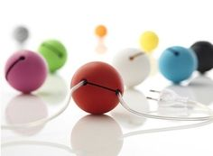 """Cord Balls:  They're like little hungry munchkins that will """"eat"""" up to five feet of cable to keep your media centers and office spaces free of clutter.  finnishdesignshop.us"""