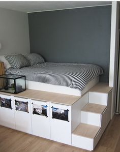 If you want extra storage, a raised bed is the way to go. Nine sturdy IKEA kitchen cabinets hold personal items.
