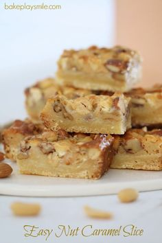 Pour condensed milk over nuts in ccoked base and bake further 20 mins.