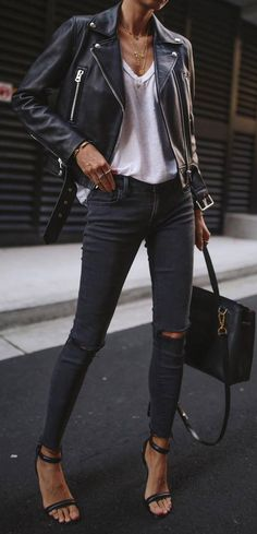 what to wear with a black biker jacket : t-shirt + bag + rips + heels