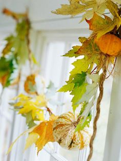 Make a festive fall garland from mini pumpkins and fall leaves. More ideas: http://www.bhg.com/decorating/seasonal/autumn/fall-harvest-decorating-ideas/