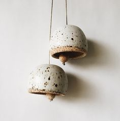 Matte white bell with speckles. *Sold separately* Bell measures 2x3 inches