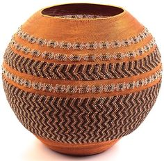 Each glass bead is individually threaded onto the copper wire and woven into the basket with very fine weaving.