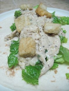 Ingredients 2 lbs boneless chicken thighs or breasts 2 cups chicken broth 1/2-1 cup Caesar dressing 1/2 cup shredded Parmesean 2 teaspoons Parsley 1/2 tsp ground pepper 2 cups shredded romaine Caes...