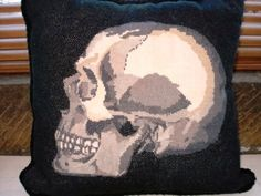 finished needlepoint skull pillow