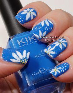 Daisy nail art on blue