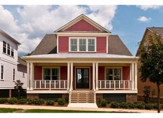 Love the spindles on the rail of this Craftsman Style Elevation with Covered Entry and Large Front Porch