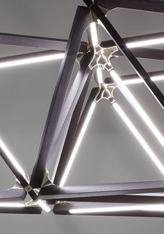 Modular contemporary lighting made with reclaimed wood.