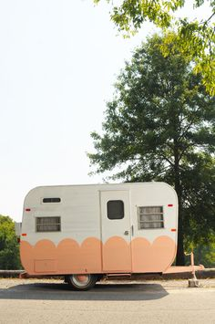 I must have a trailer like this for my backyard. I would use it as a sewing room and guest suite.