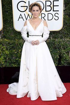Sarah Jessica ParkerCAPTION   As expected, the queen of fashion dressed to impress! Parker seemingly paid tribute to late 'Star Wars' actress Carrie Fisher, sporting a Princess Leia-esque 'do and a white Vera Wang gown with cut-outs at the shoulders.  Photo: Venturelli/WireImage