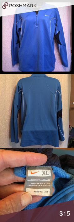Nike Fit Dri Pullover Top Here is a blue Nike FitDri Pullover top size XL (18/20). I am large but I like the bigger fit. Zipper at neck with dark navy trim (almost black), and white piping. Two slit pockets on sides. EUC . Get on your Nikes!😎😎 Nike Other