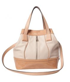 DESCRIPTION:    Medium handbag with magnet closure and a shoulder strap loop of 56 centimeters. Silver metal parts. Two small inner pockets, one zipped and one flat for the mobile. Interior made of cloth. Can wear it crossed or on your shoulder.    MEASURES (H x W x depths in cm):    30 x 35 x 10    COMPOSITION:    100% Bovine