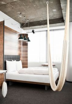 Hotel Daniel in Vienna. Dude, I would so want to stay in this hotel. I mean, a hotel room WITH A HAMMOCK! Guaranteed to be more comfy than any hotel chair I've ever seen. Hotel Daniel, Hammock In Bedroom, Hammock Chair, Bedroom Bed, Bed Room, Clean Bedroom, Hammock Swing, White Bedroom, Master Bedroom