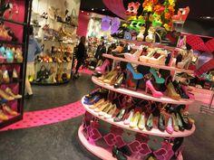 Shibuya 109 - gyaru department store in Tokyo. See photos of the cute, trendy gal brands including Liz Lisa at: http://www.lacarmina.com/blog/2013/04/shibuya-109-tokyo-gyaru-shopping-asia-designer-clothes-shoes/    neon high heels, tokyo trendy heels, cool shoes