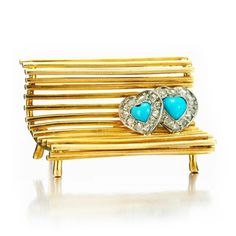 A Turquoise and Diamond 'Lovers on a Bench' Brooch, by Cartier. FD Gallery. (=)