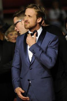 Ryan Gosling, in a tux, making a precious face.